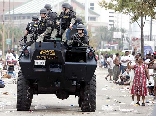 SWAT team drives past Convention Center, New Orleans.